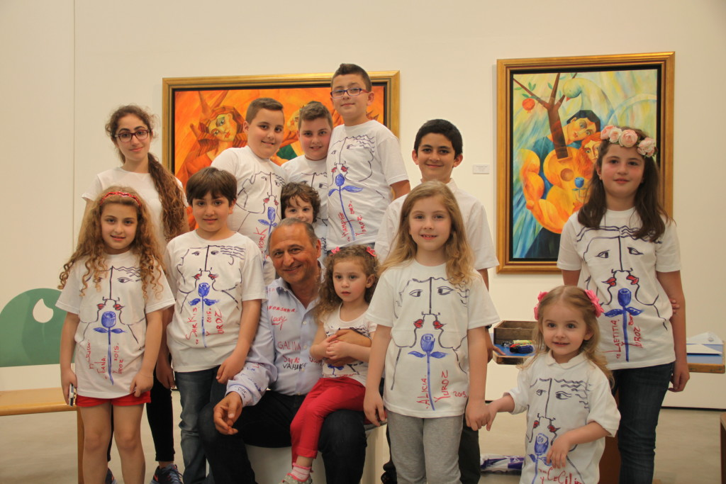 Yuroz with children drawing on t shirts